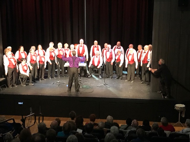 Chorus in red vests
